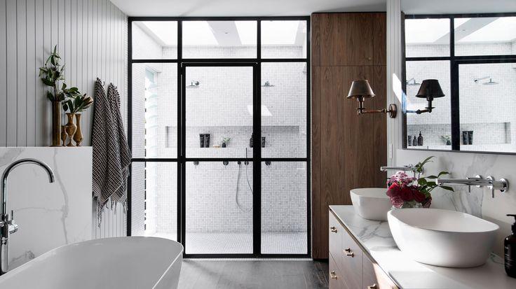 black framed shower doors, grey & white bathroom