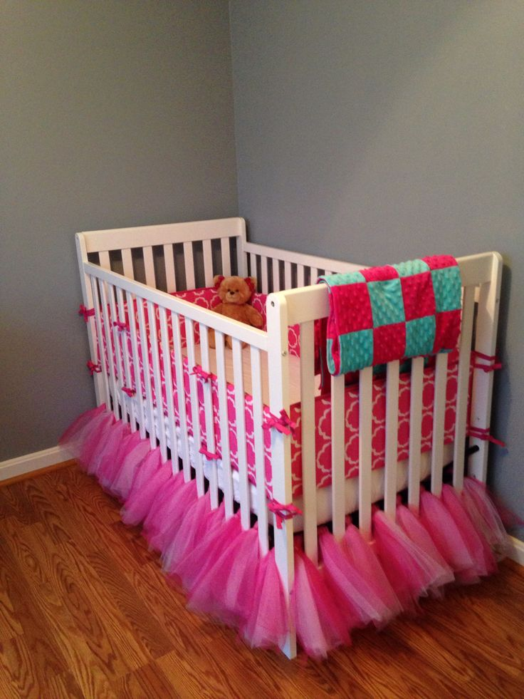 Hot pink and turquoise baby bedding with a homemade tutu crib skirt. Love my baby girl's room!!