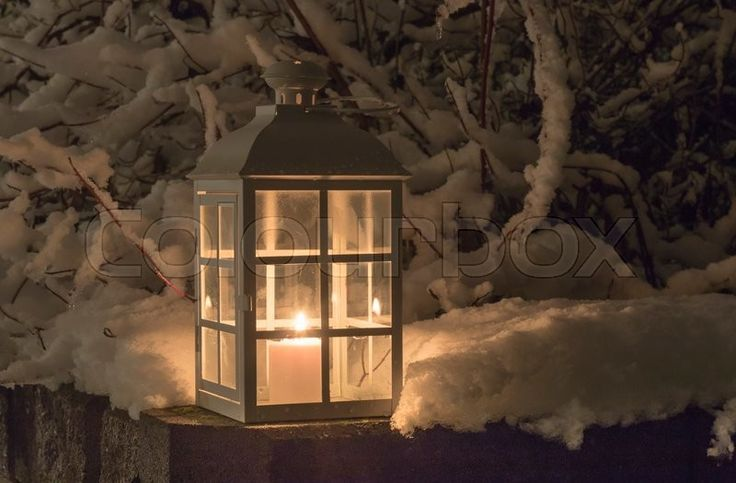 Lantern with a candle and snowy branches | Stock Photo | Colourbox on Colourbox