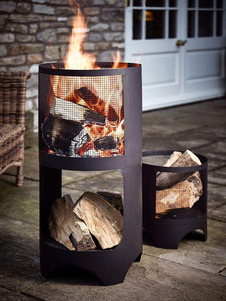 Perfect for cool Spring nights, our tall fire basket comprises of a large standing chimney style brazier and a smaller open top brazier. Made from strong black iron with a sand blasted finish, our large chimney style brazier includes a handy shelf for filling with firewood, a tall open top and mesh wire sides. The smaller can be used as a traditional open top brazier, or filled with firewood and used as a hand log basket.