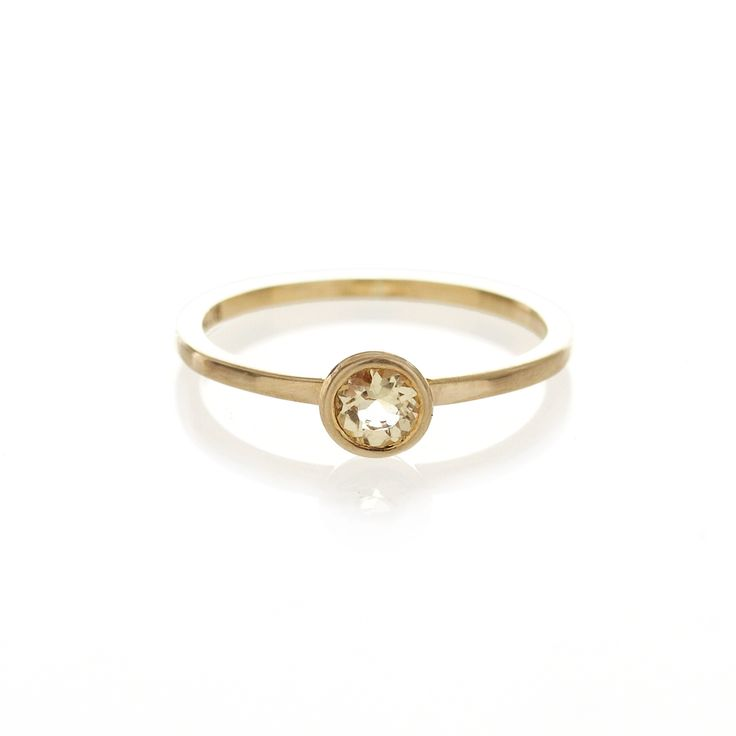 A 9ct yellow gold ring with a bezel set, 4mm, brilliant cut Citrine.  When ordering one of our gold luxury rings please provide us with your exact ring size. This can be done in the in 'anything else?' field once your order has been placed.  To find out more about ring sizes please visit the information page on the menu above.  Our luxury gold rings are only available to ship within South Africa.