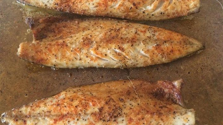 This simple recipe for fish cooked under the broiler uses lemon slices, paprika, salt, and pepper to season fresh Spanish mackerel.