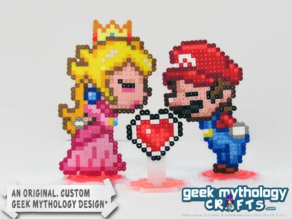 Super Mario Bros - Mario & Princess Peach Kissing by Geeks at Heart, $22.00  - https://www.etsy.com/listing/178747036/super-mario-bros-mario-princess-peach - A wedding cake topper, center piece, or just cute stand-up decorations for your geeky party or reception, featuring Super Mario and Princess Peach.