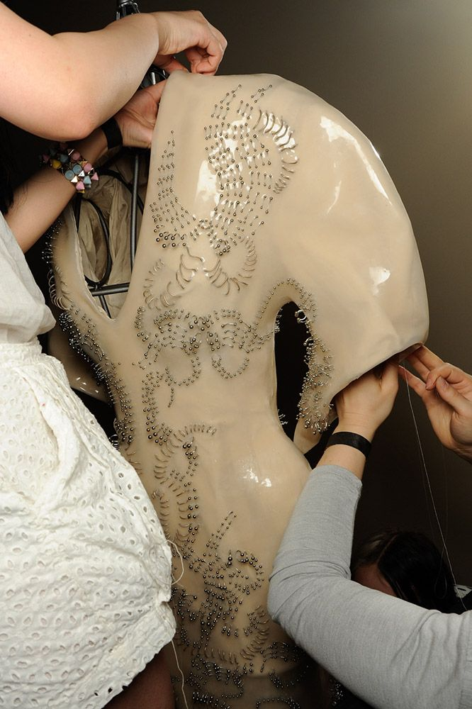 Backstage Fashion - couture behind the scenes - backstage at an Iris van Herpen catwalk show, prepping one of the sculptural creations for the catwalk