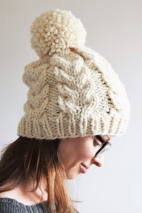 ab897142b5b Free knitting pattern for Cable Pom Pom Hat - The chunky cables paired with  super bulky yarn make for an enjoyable and quick knit