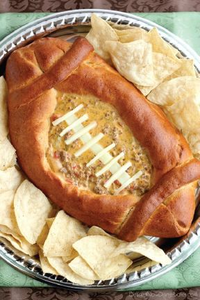 Score a touchdown on game day with this crazy-awesome Football Dip Bowl! Filling a bread bowl full of queso is a great way to pump up your party spread for Super Bowl Sunday.