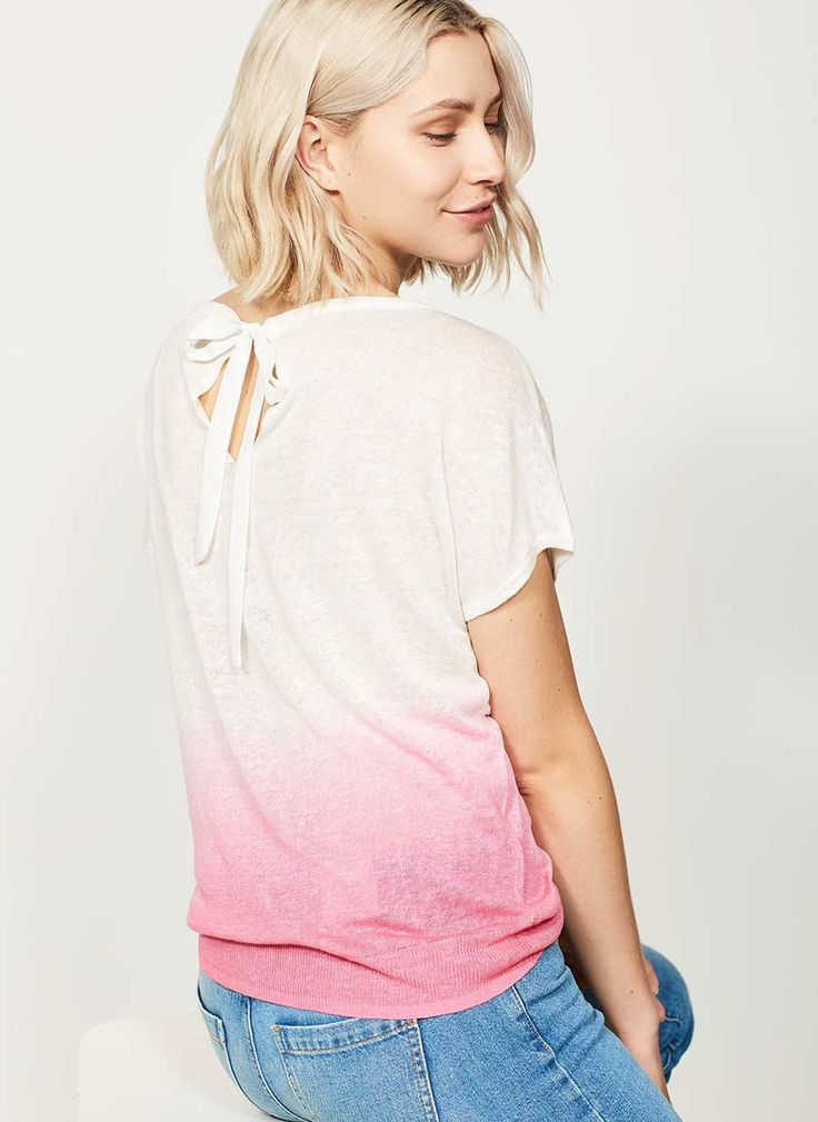 Opt for easy weekend style in this peony and ivory ombre knit. With a flattering batwing scoop neckline and tie back detail, pair with your favourite cut off jeans for a relaxed glamour look. Model is 5'10in and wears a UK size 10. The length from the side neck point to front hem measures 60cm/23.5in.