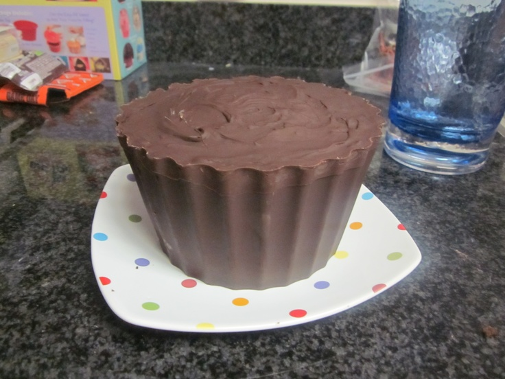 Peanut Butter Cup Cake - Made using the Big Top Cupcake pan and creating a melted chocolate shell to then fill with chocolate peanut butter chip cake and peanut butter buttercream and top with more melted chocolate.  Yum!