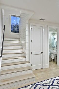 Attractive cottage staircase and foyer. Modern Farmhouse - Redbud Custom Homes