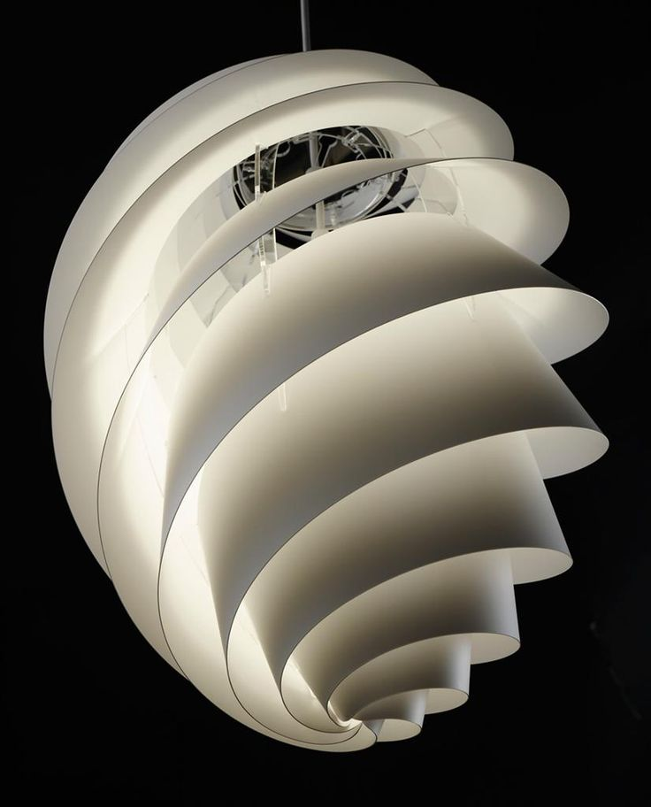 Swirl lamp light and delicately by Le Klint for contemporary interior lighting