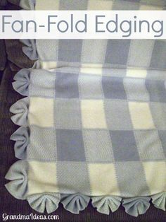 "This fan-fold edging is an extremely easy way to finish off a baby blanket's edging. Make 4"" cuts 4 inches apart, fold like a fan, and zig-zag in the center."