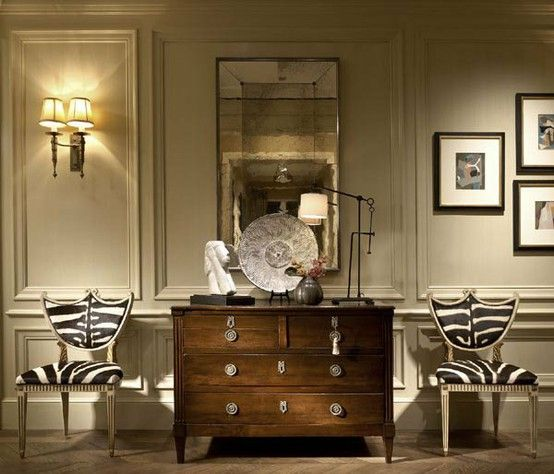 A charming melange of timeless furnishings & decor - Zebra chairs, that lamp, chest of drawers & mirror....very chic.