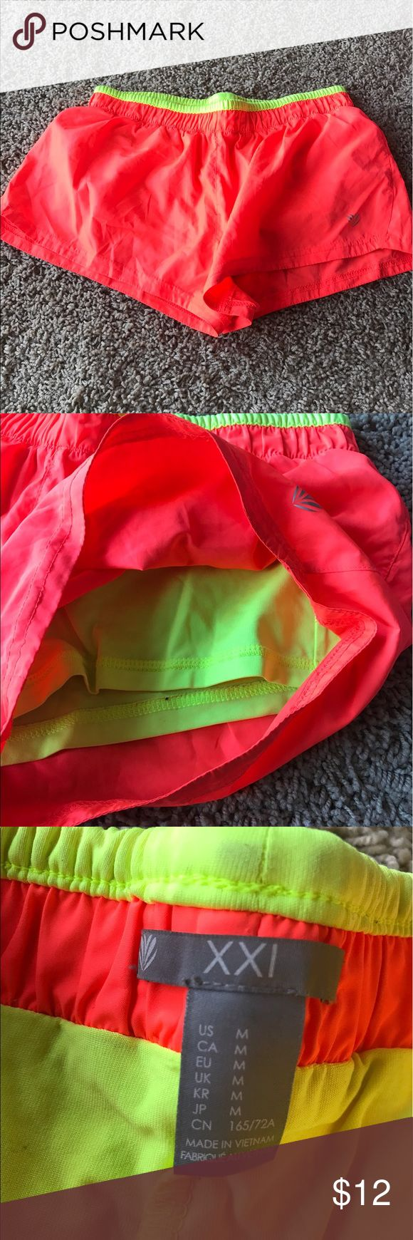 Neon forever 21 workout shorts! Neon forever 21 workout shorts. Worn only twice!! Bright pink/orange color and neon green shorts underneath. Size medium Forever 21 Shorts