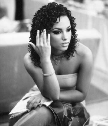 Alicia Keys - I love her. She's amazing. She is an amazing piano player and her music is soulful and comes from the heart. If I were to do music, I want to do music like her and treat my career like she has, with grace and poise. She's awesome!