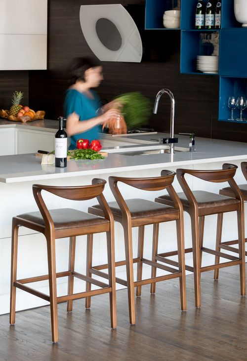 The Duda Stool counter height by Brazilian Aristeu Pires warms up any kitchen