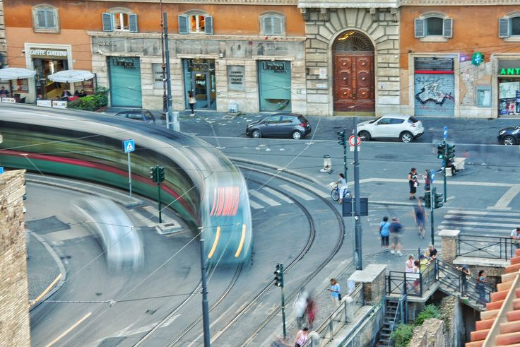 Largo Torre Argentina The Tram heading to the Piazza Venezia streak through the intersection