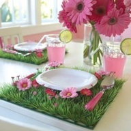 Pink daisy grass place mats. Cute idea for a fresh spring gathering.