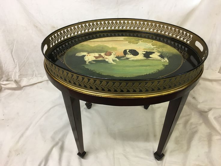 Antique painted tray on stand . Picture depicting two family dogs. Tray sits on stand with four tapered legs and gilt edge
