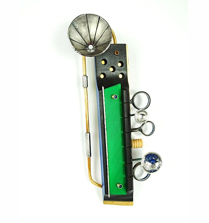 Lisa & Scott Cylinder - Vibe Brooch, 2015, Brass, sterling silver,nickle silver, vintage guitar and clarinet parts, bone, vinyl, lapis lazuli, paint, 5.75 x 2.75 x 1""