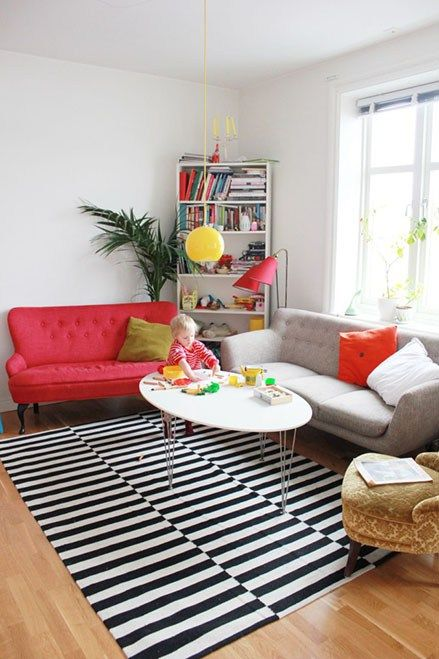 I have a red couch from Ikea in the living room and I found some great ways to make it look nice. How would you style a red couch?