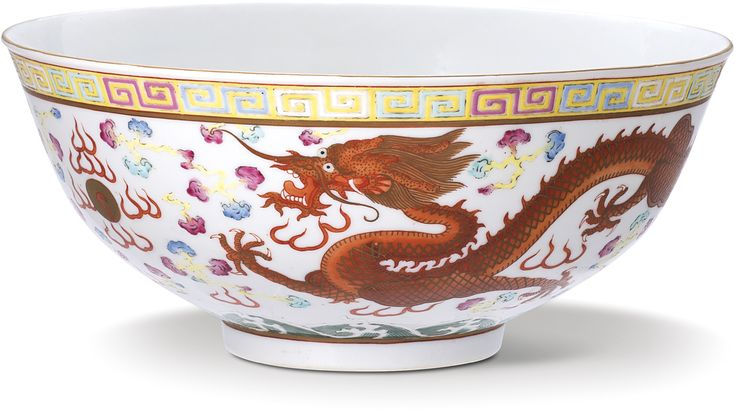A FAMILLE-ROSE 'DRAGON AND PHOENIX' BOWL MARK AND PERIOD OF GUANGXU decorated with an iron-red dragon in pursuit of a 'flaming pearl' and a phoenix flying towards a rising sun, the rim bordered with multicoloured keyfret, the base inscribed in iron-red with a six-character reign mark