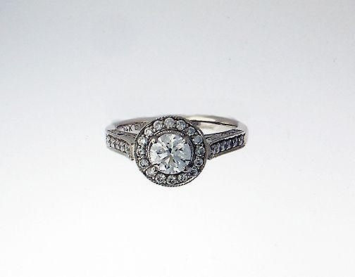 14k white gold halo ring .60ct center diamond $2,000.00