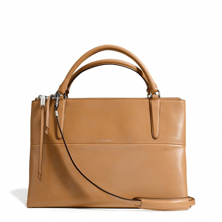 COACH | The Borough Bag in retro glove tan leather in Tan | Leather, fabric lined | Inside zip, cell phone and multifunction pockets. Zip-top closure. Handles with 12cm drop. Strap with 34cm drop for shoulder wear. | 35cm (L) x 23cm (H) x 14cm (W) | £575  Note: despite its price, this bag does not have metal feet.