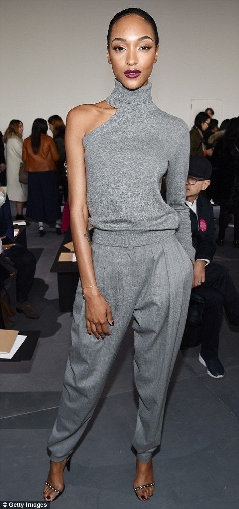 Shades of grey:Jourdan Dunn showed off her slim figure in a sleeveless top and matching trousers