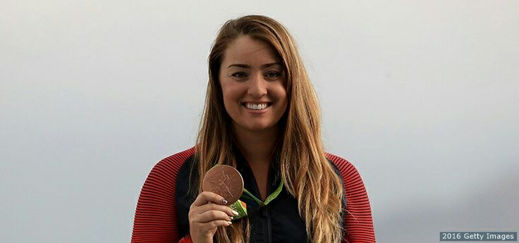 Corey Cogdell-Unrein smiles on the podium at the medal ceremony for the women's trap shooting event at the Rio 2016 Olympic Games at the Olympic Shooting Centre on Aug. 7, 2016 in Rio de Janeiro.