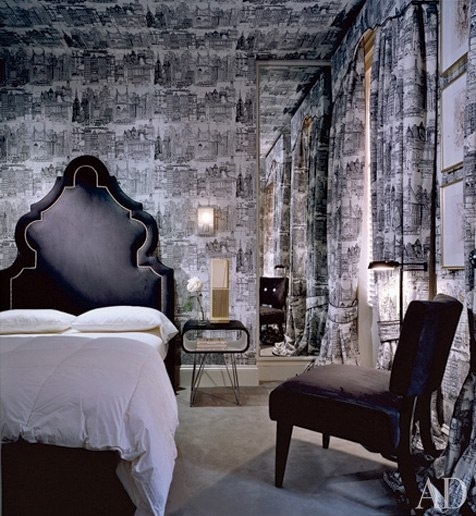 n the guest room of his Manhattan townhouse, AD 100 decorator Geoffrey Bradfield experimented with a black-and-white toile depicting the city skyline to create a modern take on a traditional design concept. The upholstered headboard was inspired by one in a Dubai hotel. (September 2005)