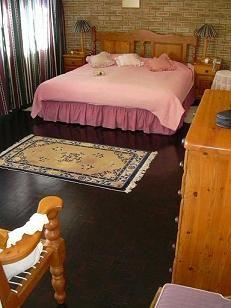 Ebony all black. Glossy finish.  Bed room