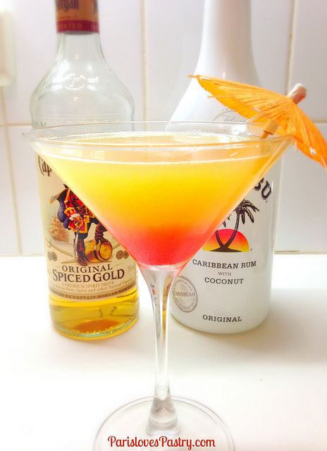 Caribbean Rum Cocktail - - - 3 ounces fresh pineapple juice - 2 ounces fresh orange juice - 1 ounce gold (or dark) rum + 1/2 ounce to pour on top - 1 ounce coconut rum, - grenadine - lime to garnish