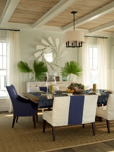 Love the upholstery and oars mirror.  East Beach Coastal Living Idea House by Phoebe Howard  Another great beach house find!