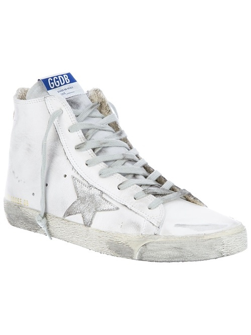 White leather trainers from Golden Goose featuring an ankle cut, a round closed toe, a star detail on side, front lace fastenings, a worn look and a white sole.