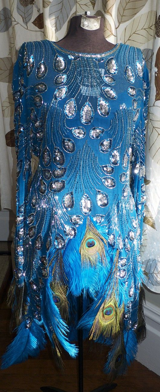Burlesque Costume Silk Dress Peacock Ostrich by DelilahBurlesque ~ Burlesque Costume Silk Dress Peacock Ostrich Feather Sequin Beads $300.00 USD Only 1 available Overview Handmade item Materials: sequins, beads, ostrich feathers, peacock feathers, swarovski crystals, silk Ships worldwide from New York, United States