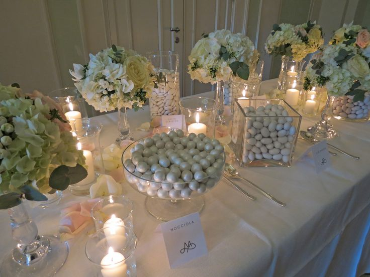 Decorations with white hydrangea, roses, bouvardia, eucharis, pale pink roses and greenery.