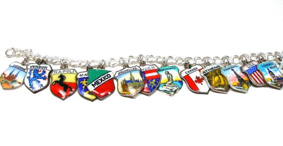 25 vintage silver & enamel travel shield charms on a new sterling silver bracelet.  Charms are all different with an assortment of countries, cities & landmarks. Includes the Eiffel Tower, Big Ben, Sweden, Rome, Nova Scotia, Copenhagens Little Mermaid, Madrid, Portugal, Mexico, Athens, Switzerland & more.  Most charms are marked 800, 835, 900, or sterling silver. A couple are unmarked & may be plated. All charms are vintage & may show age related wear.  Sterling silver bra...