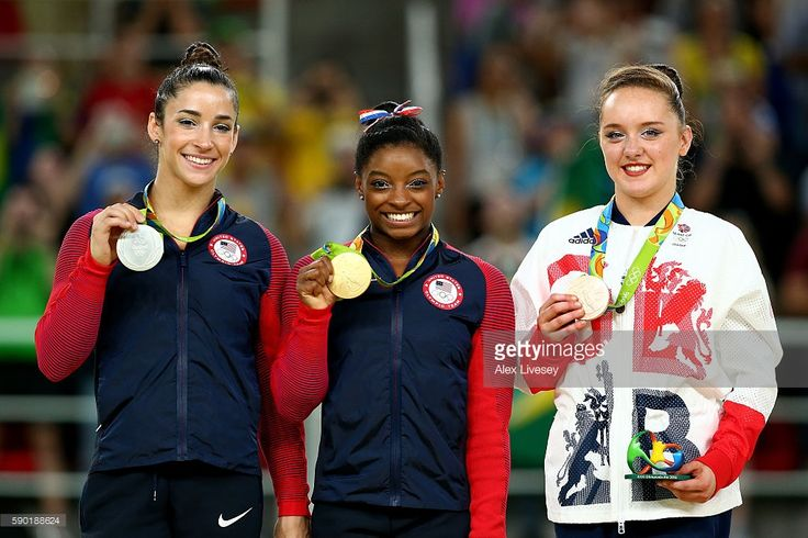 Silver medalist Alexandra Raisman of the United States, gold medalist Simone Biles of the United States and Amy Tinkler of Great Britain pose for photographs on the podium at the medal ceremony for the Women's Floor on Day 11 of the Rio 2016 Olympic Games at the Rio Olympic Arena on August 16, 2016 in Rio de Janeiro, Brazil.