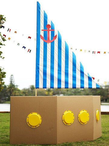 """Craft this boat from cardboard boxes as the centerpiece of the party.                 Boat: What you'll need 2 cardboard boxes (22""""x22""""x22""""), clear packing tape, yellow plastic cake plates, hole punch, black brads, glue                 Make it: 1. Fold flaps into boxes. Tape to secure if needed, leaving one slit open for kids to enter. 2. Slice boxes at 1 corner seam per box and tape together to form a boat shape. 3. Punch 8 holes around plates, and insert a brad into each hole.  4. Glue…"""