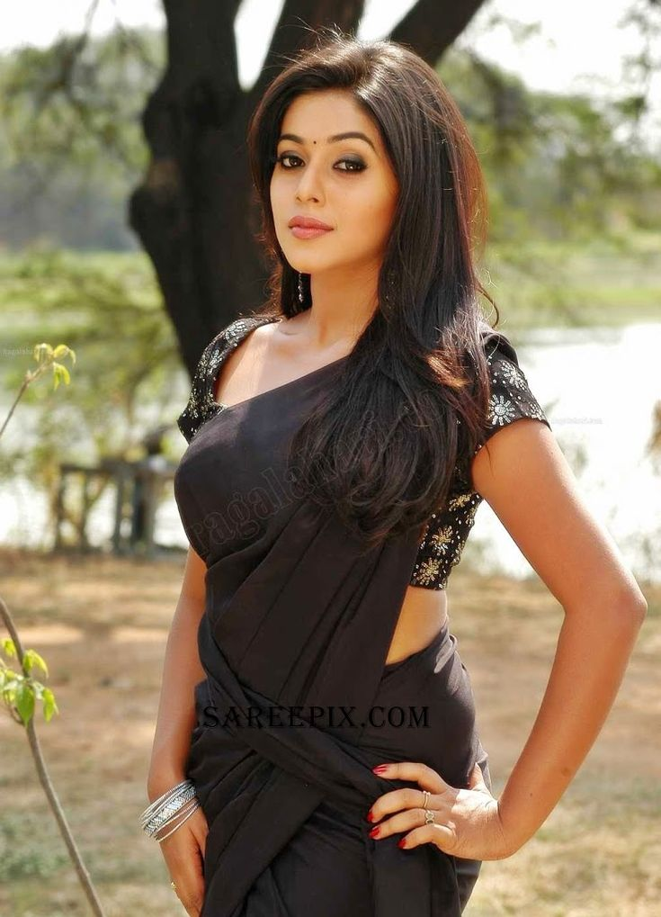 """Actress Poorna alias Shamna kasim stills in black saree with designer blouse. She acted in telugu movie """"Avunu"""". Currently she is acting in tamil and malay"""