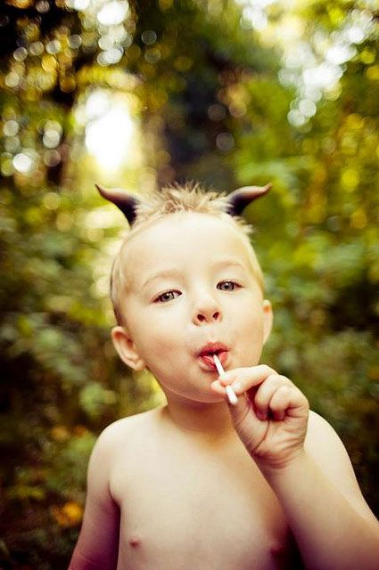 Child + satyr horns + lolly = amazing shot I want this little Puck to frolic in my pasture! Crazy cute!