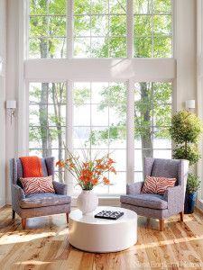Twin wing chairs with a modern vibe invite settling in.