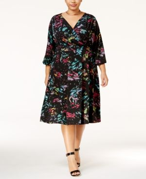 Lose yourself in the kaleidoscopic print of Melissa McCarthy Seven7's plus size surplice dress. | Polyester; lining: polyester | Machine washable | Imported | Exposed zipper closure at back | Hits bel