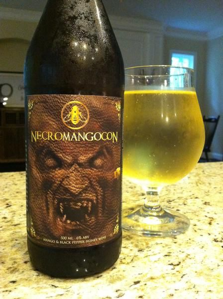 BrewChief.com Review of Necromangocon (B. Nektar Meadery) : Happiness comes in many forms, be it reading a favorite book or sitting down at a favorite restaurant. For this beer fan, one nugget of reliable happiness is the mango. I care not how it's used and it instantly betters whatever it touches. Mango salsa? Heaven. Mango smoothie? Hell yes. Dried mango? Snackalicious. So, the moment I came across B. Nektar's Necromangocon, you might say that the decision was already made for me...