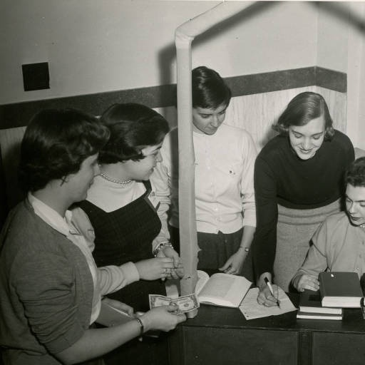 Saint Rose students in 1956 participating in an annual book exchange.     Taken from Saint Rose Archives- Photograph Collection. Find more at : http://library.strose.edu/archives