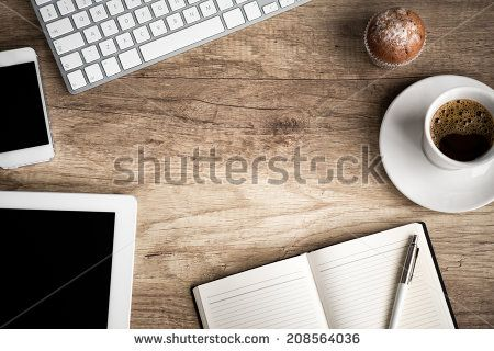 Wooden  table with office  supplies, top view - stock photo