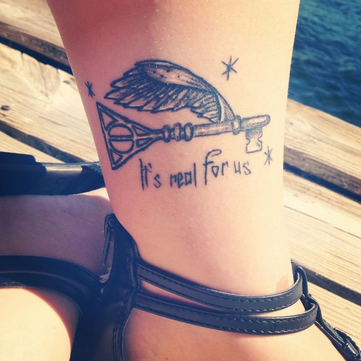 Great Harry Potter tattoo... It's the flying key from the first book with the deathly hallows signattached.