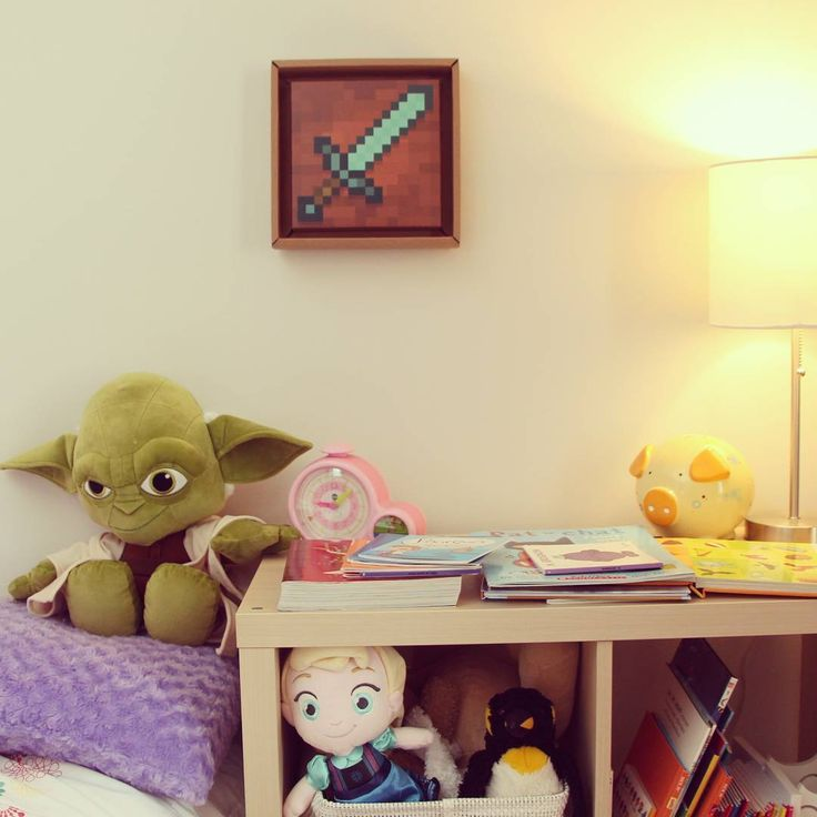 Creating a #diamondsword frame with #tonki is a great way to recreate #minecraft art for a kid bedroom! It complement  #yoda and #elsa ! I will add to this wall but what do you suggest I frame next? A pickaxe or a compas maybe? #idea #decorideas #tonki_design