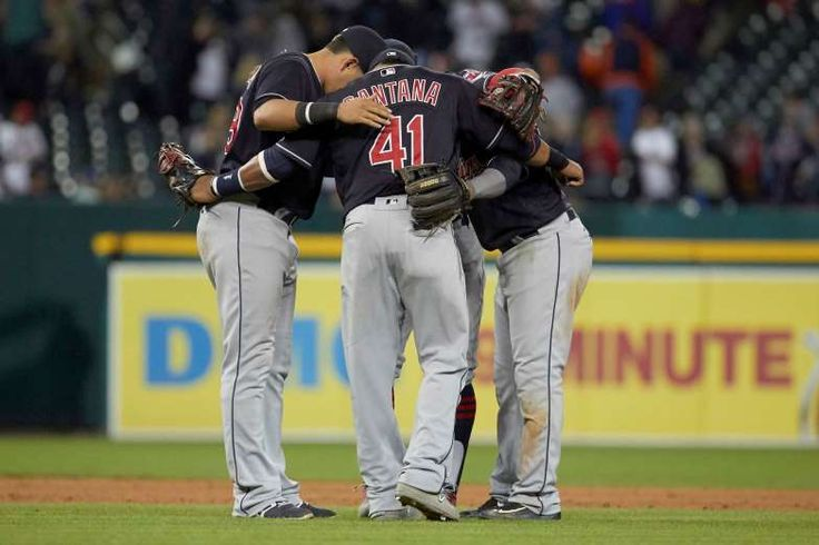 SECRET TALK:   Indians players, from left, Giovanny Urshela, Carlos Santana, Francisco Lindor and Jose Ramirez celebrate after defeating the Tigers 5-2 on Sept. 2 in Detroit.