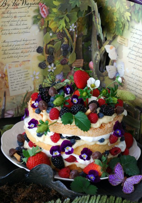 A cake fairies can appreciate~ an angel food cake, cut in thirds, layered with lemon curd, whipped cream, berries & chocolate mushrooms :-)